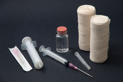 Injection with a needle, a vaccine and a bandage on a black back Stock Photo