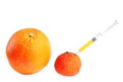 injection orange Image libre de droits