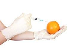 Injection into orange Stock Photography
