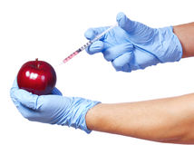 Injection into red apple Stock Photography