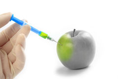 Injection vitamin in apple Stock Image