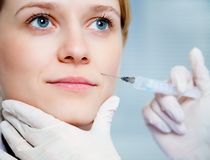 Injection of youth. Close-up of a woman's face with the introduction of a youth serum Stock Photo