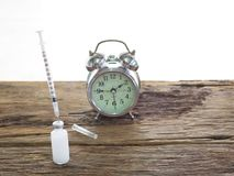 Injections, bottles, pills and watches mean that time for injection for diabetics requires insulin injections.  Royalty Free Stock Photography