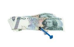 Injektionsspruta och pengar Royaltyfria Foton