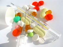 injektionssprutan tablets termometern Arkivbild