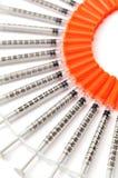 Injektionssprutor i en cirkel Royaltyfri Bild