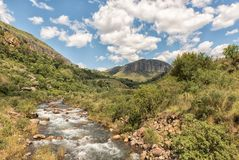 Injisuthi river in the Kwazulu-Natal Drakensberg. The Injisuthi river in the Kwazulu-Natal Drakensberg as seen from the road bridge near Injisuthi camp Stock Photo