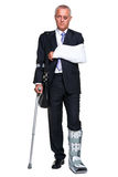 Injred businessman on crutches on white Royalty Free Stock Photo