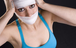 Injured Woman Feels the Pain of Head Injury Stock Photography