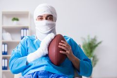The injured american football player recovering in hospital royalty free stock image