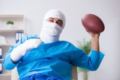 The injured american football player recovering in hospital stock photography