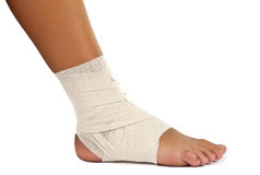 Injured ankle with bandage Royalty Free Stock Photography