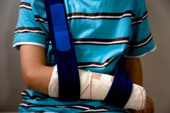 Injured arm in a sling royalty free stock photography