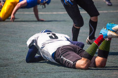 Injured athlete lies Stock Photo