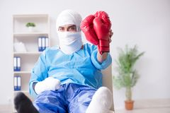 The injured boxer recovering in hospital. Injured boxer recovering in hospital Royalty Free Stock Image