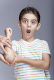 Injured boy with a a bruised elbow reacts in pain Royalty Free Stock Photo