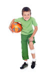 Injured boy with soccer ball. Boy with bandage on injured leg holding soccer ball - isolated Royalty Free Stock Photo