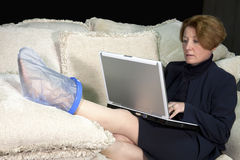 Injured Business Woman on Sofa Stock Image