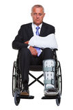 Injured Businessman In A Wheelchair Isolated Stock Images