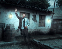 Injured businessman near an old house Stock Photography
