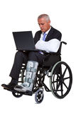 Injured businessman in a wheelchair isolated Stock Image