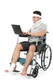Injured bussinessman work on his laptop Royalty Free Stock Image