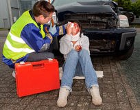 Injured in a car accident. Paramedic caring for an injured women after a car accident Stock Photos