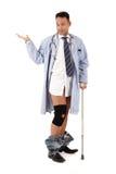 Injured caucasian man doctor Stock Images