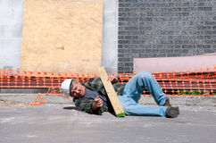 Free Injured Construction Worker At Work Site Royalty Free Stock Image - 33012576