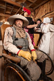 Injured Cowboy in Wheelchair Royalty Free Stock Image