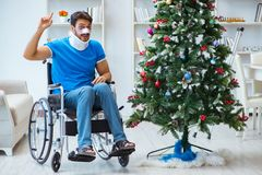 The injured disabled man celebrating christmas at home Royalty Free Stock Image