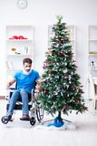 The injured disabled man celebrating christmas at home Royalty Free Stock Photo