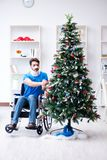 The injured disabled man celebrating christmas at home Royalty Free Stock Photos