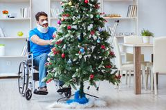 The injured disabled man celebrating christmas at home Stock Image