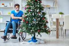 The injured disabled man celebrating christmas at home Stock Images