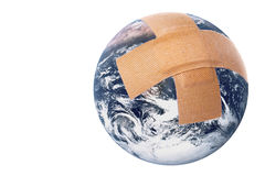 Injured Earth Isolated. Isolated image an injured planet earth with first aid plasters Royalty Free Stock Photos