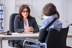 The injured employee visiting lawyer for advice on insurance. Injured employee visiting lawyer for advice on insurance royalty free stock photo