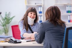 The injured employee visiting lawyer for advice on insurance. Injured employee visiting lawyer for advice on insurance royalty free stock photography