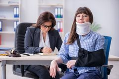 The injured employee visiting lawyer for advice on insurance. Injured employee visiting lawyer for advice on insurance stock image