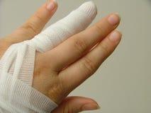 Injured finger. Injured and bandaged finger Royalty Free Stock Photography