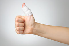 Injured finger with bandage Stock Photography