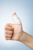 Injured finger with bandage Royalty Free Stock Photography