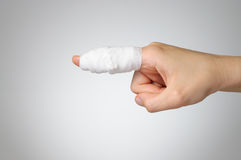Injured finger with bandage Royalty Free Stock Images