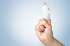 Injured finger with bandage Stock Photo