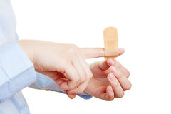 Injured finger getting band-aid Royalty Free Stock Photos