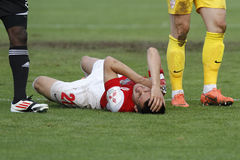 Injured football player. (Dragos Grigore) lying on the football pitch in the match between Dinamo Bucharest and Gaz Metan Medias, Romania, League 1 Stock Images
