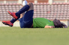 Injured football player on the ground Stock Image