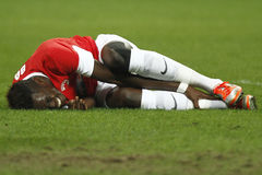Injured football player. (Issa Ba) lying on the football pitch in the match between Dinamo Bucharest and Gloria Bistrita Stock Photography