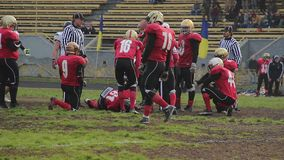 Injured football player lying on field, suffering pain, waiting for first aid. Stock footage stock video footage