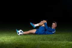 Injured Football Player Lying On The Ground Royalty Free Stock Photography